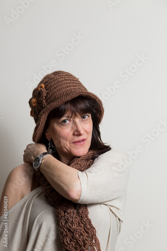 attractive brunette woman with hat and scarf