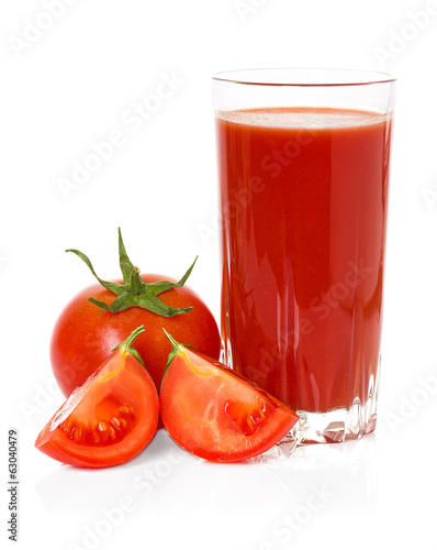 Drinking glass with tomato juice and ripe fresh tomato