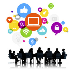 Business People in Meeting and Social Media