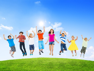 Group of Diverse Multi-Ethinc Children Jumping