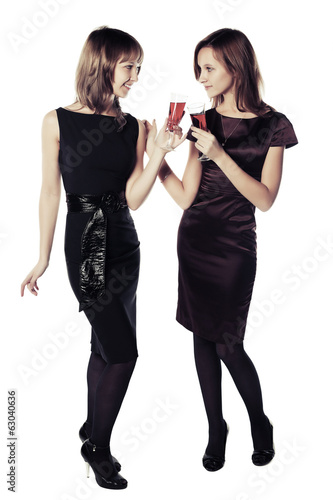 Two young women with a red wine glasses