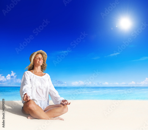 Beautiful Woman Doing Yoga On Beach
