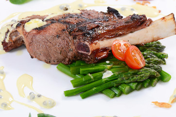 rack of lamb on grill with an asparagus