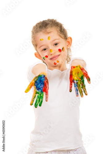 Girl showing messy colorful hands