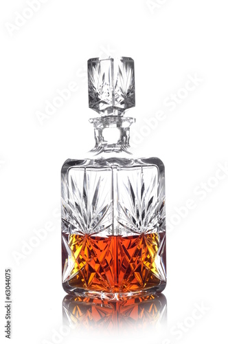 Whisky in carafe isolated on white