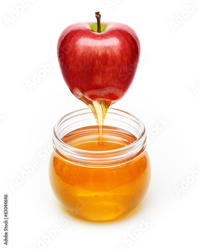 Red apple with honey bowl isolated on white background.