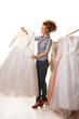 Young beautiful woman is choosing wedding dress