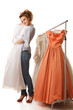 Young beautiful woman is choosing wedding dress