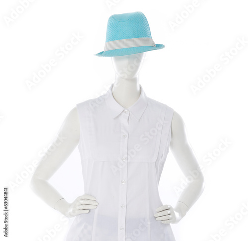 female white shirt clothing in blue hat on mannequin