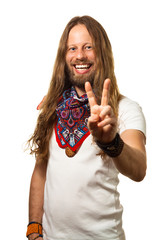 Happy and handsome hippie  guy giving a peace sign.