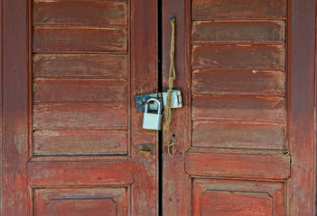 master key on wood door and key knob