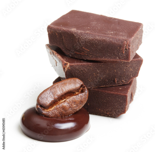 Pieces of chocolate, drop and coffee grain on a white background