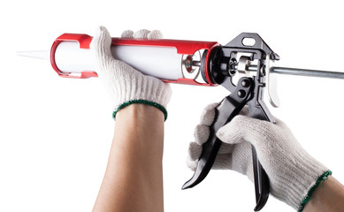 Worker applies silicone caulk gun isolated on white background