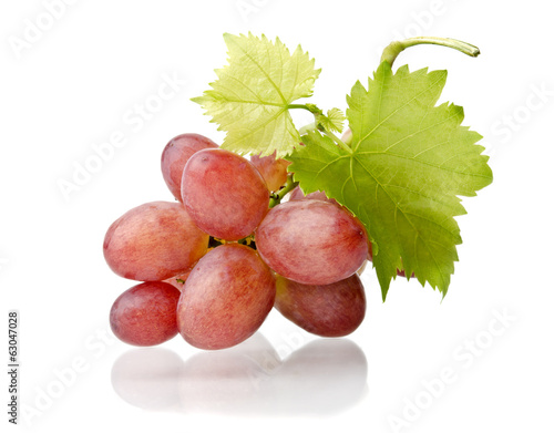 Grape cluster with leaves isolated on a white background