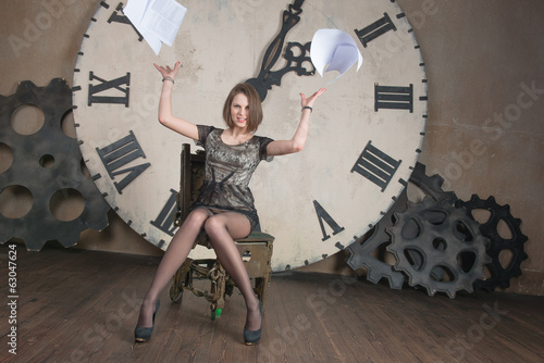 Beautiful girl throwing documents