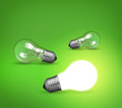 idea concept whit glowing light bulb on green background