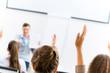 female hand raised in class