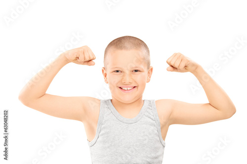 Little boy showing muscles