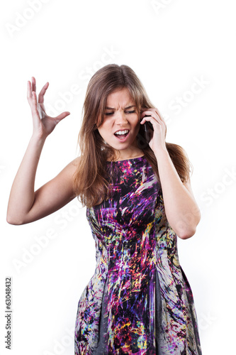 Upset girl talking on the phone