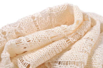 Stack of white openwork knitted fabric