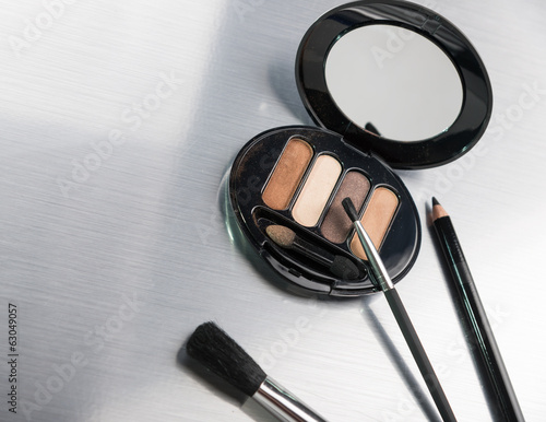 Make-up set on metallic surface