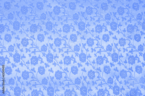 Blue silk with flowers as background