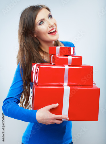 Portrait of young happy smiling woman hold red gift box. Isolat