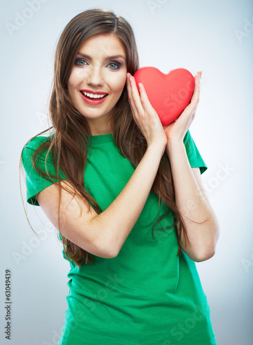 Red heart. Love symbol. Portrait of beautiful woman hold Valent