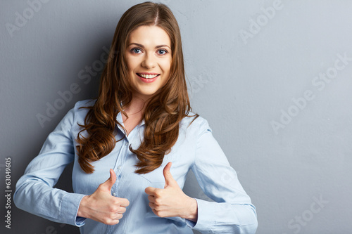 Business woman show thumb up.