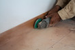 He dismantle tiled with hand grinder