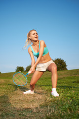 badminton player in action . Outdoor sport