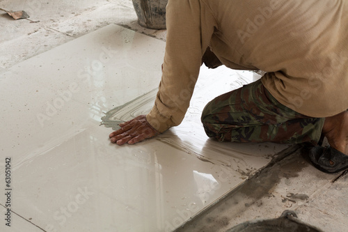 He will tiled and press tile