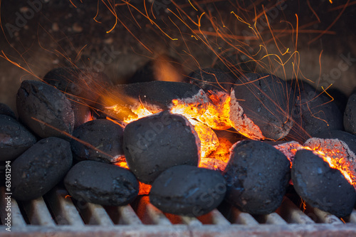 Charcoal briquettes with fire sparks.Barbecue design. - 63051294