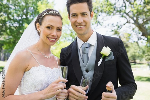 Newly wed couple holding champagne glasses