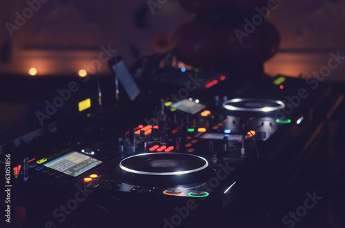 Disc Jockey mixing deck and turntables
