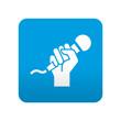 Etiqueta tipo app azul simbolo karaoke