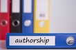 Authorship on blue business binder