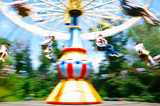 child playing flying swing in park, motion blur shot