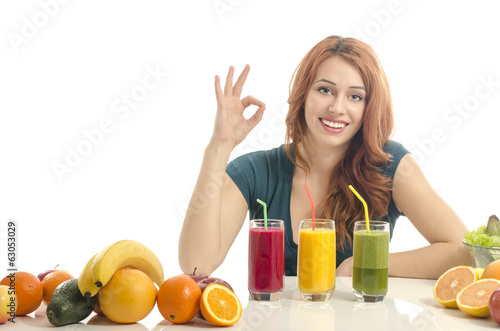 Happy woman having a table full of organic food,juices, smoothie