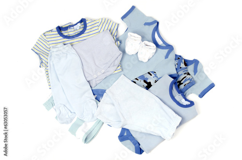 Close up with a blue stack of clean baby clothes isolated