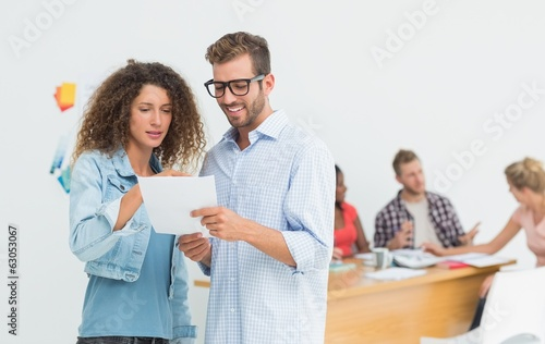 Attractive designers looking at digital tablet together