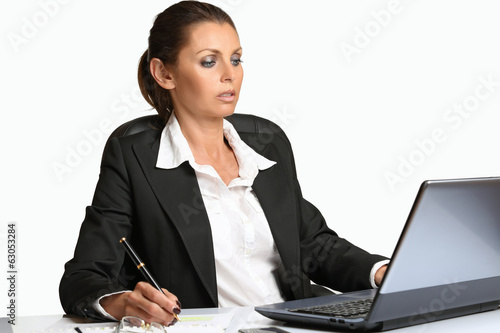 Beautiful manager works with laptop
