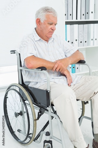 Sad senior man sitting in wheelchair