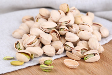 Pistachio nuts on fabric background