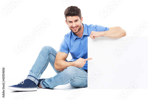 Sitting man with empty poster