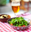 One glass of light beer with salad