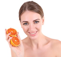 Beautiful young woman holding orange, isolated on white