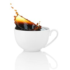 Cup of coffee with splash, isolated on white