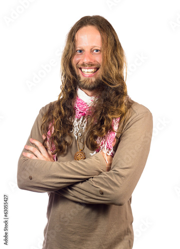 Handsome and happy hippie with arms folded on white.