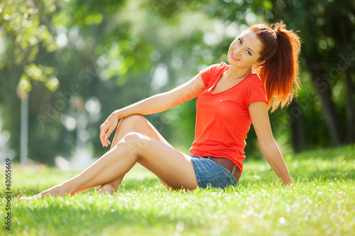 Young pretty woman relaxing in the park